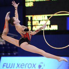 Ukrainian rhythmic gymnast Alina Maksimenko performs with a hoop
