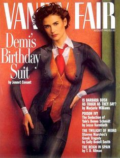 Demi Moore photographed with a men's suit painted on her body for a 1992 Vanity Fair cover by Annie Leibovitz.
