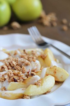 Baked Apples tossed in maple syrup and served with spiced yogurt and granola. Easy and healthy dessert, snack or breakfast!