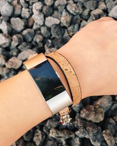 Please read full description and see photos prior to purchasing. Leather band accessory for FitBit Charge 2. Adjustable strap wrap bracelet style a buckle closure in natural Cork leather. See above photos. Includes adapters in the color of your choice and comes ready to attach to your