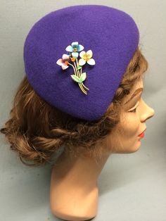 This desirable felt fascinator is the Lucille! It has an asymmetric shape and a sloping crown which forms a tear-drop shape. Trimmed with a beautiful vintage brooch. Colour: Purple #Fabhatrix #Edinburgh #Grassmarket #felt #fascinator #occasion