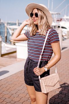 4 Things to Consider When Putting Together a Nautical Outfit. - How to put together a nautical inspired outfit that isn't overkill. - navy linen shorts, straw boater hat, straw crossbody bag, navy outfit, nautical summer outfit, vacation outfit, beach outfit, boat outfit, casual summer outfit, classic summer outfit, classic style, nautical style, metal framed sunglasses
