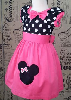 A Beautiful Peasant Dress, the perfect dress for your little one Disney trip!!!  A Peasant Dress with a Minnie Mouse Bow applique What a fun and