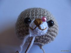 Eyes play an important role of Amigurumi doll,they will give a unique personality of each doll.I would like to share a little tips,that I normally use.  First. stuffing polyester firmly and put plastic eyes on and following by nose, do not sewing or attach anything yet because we can adjust position of the eyes and nose.