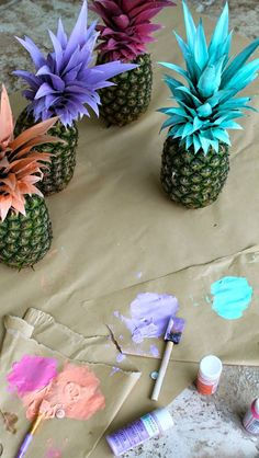 Painted pineapples-possible decoration for Hawaiian themed event