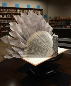 book folding, turkey decoration made from open book, with folded pages, decorated with paper cutouts, and twisted paper cones Folded Book Art, Paper Book, Paper Art, Paper Crafts, Cut Paper, Old Book Crafts, Book Page Crafts, Book Turkey, Altered Book Art