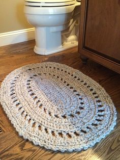 I could never find a small, cute rug to fit our little bathroom so I made one! This is a pattern from Ravelry.com, and I followed the pattern but used 2 strands held together of Lion Brand Wool-Ease Thick and Quick yarn and a size P crochet hook.: