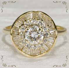Totally in love with this ring! vintage, yellow gold, circular + baguette and round diamonds. so pretty.