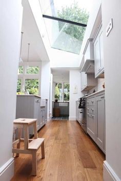 Skylights and white cabinetry make this kitchen feel extra light, airy and clean!