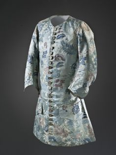 Man's sleeved waistcoat, France, c. 1715. Pale blue silk lampas with supplementary werft patterning, floral motifs.