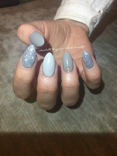 Grey ice cnd acrylic nails almond shaped, with customised mixed colours and Swarovski.