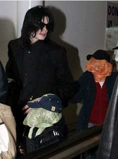 Michael Jackson with his two sons Prince Michael (age 10) and Blanket (age 5) in 2007.