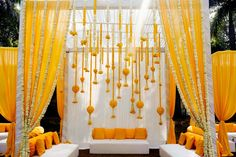 Looking for Mehendi yellow mandap seating idea? Browse of latest bridal photos, lehenga & jewelry designs, decor ideas, etc. on WedMeGood Gallery. Desi Wedding Decor, Wedding Hall Decorations, Marriage Decoration, Wedding Mandap, Lilac Wedding, Backdrop Decorations, Wedding Ideas, Backdrops, Wedding Story