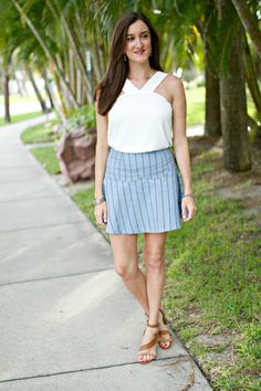 The perfect outfit for a summer beach vacation! White top with a blue mini skirt. Summer Outfit Ideas for Women