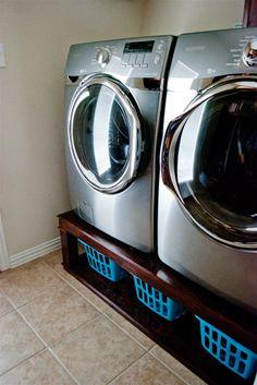 baskets under the washer & dryer!