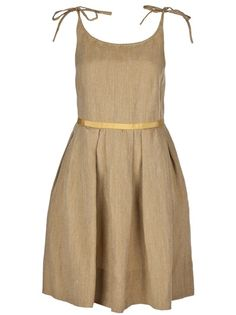 Tan seed cloth Dress from Karen Walker featuring tie shoulder straps, a belted waist and pleated skirt section.