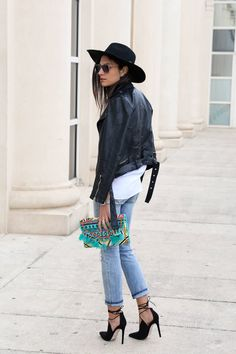 Federica L. shows us yet another cute spring outfit idea here, as she pairs faded denim jeans with a leather jacket and an authentic aztec style clutch. Throw in a pair of sexy black stilettos to complete this winning look! Shirt: Mango, Jeans: Asos, Jacket: Pull & Bear.