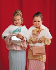 Glam up your young lady with a faux-fur wrap, flea-market brooches, grown-up attire and jewels, and an elegant hairdo.