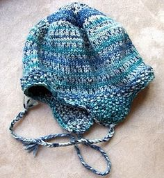 Knitted hat with ear flaps. I would love to learn how to crochet...mom did this stuff all the time--freehanded!!!