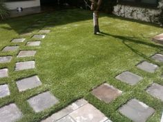 Stepping stones inserted into synthetic turf design