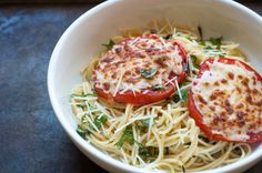 Spaghetti with cheesy broiled tomatoes and fresh basil.  If you love pizza and pasta, then you will love this dish.