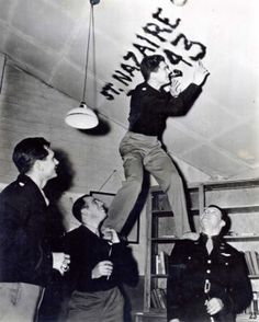 After each mission, the men of the 306th BG would take a candle and smoke the ceiling of the officers' club with the date and target for the day's mission. (The 306th Bomb Group Historical Society, Dr. Thurman Shuller collection.)