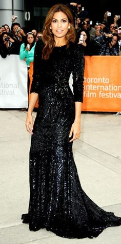 Look of the Day › September 20, 2010 WHAT SHE WORE The actress arrived at the Toronto International Film Festival premiere of Last Night in a long sequined Andrew Gn gown and Cartier diamonds. WHY WE LOVE IT Eva Mendes channeled a '40s femme fatale in a curve-hugging gown with a demure neckline and three-quarter length sleeves. Subtly embellished cut velvet gave the film noir design a seductive shimmer.