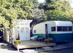 Rehabbed 60s camper becomes a backyard guest house with an amazing built on deck that doubles the square footage