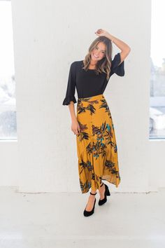 Fall floral maxi skirt with front slit and front buttons Model is wearing a size small Shown paired with our Nuna Ruffle Top