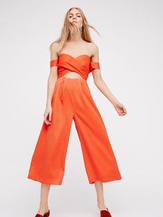 Reflections Jumpsuit   Silky one piece jumpsuit featured in an off-the-shoulder silhouette.    * Crisscross detailing on the bodice.   * Cutout at the underbust.   * Hidden back zip closure.   * Non-slip band along the bust.   * Cropped inseam.