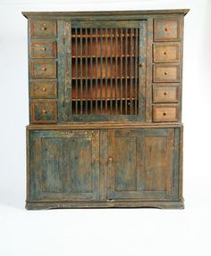 """STEPBACK CUPBOARD.  From the Jerico Tavern, Bainbridge, New York, mid 19th century, pine.  Scrubbed down to worn blue with salmon on the drawer pulls.  78""""h. 62""""w. 17 1/4""""d."""