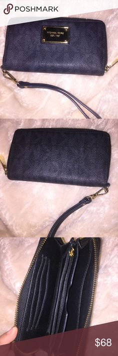 Michael Kors Wristlet Wallet! Great condition! Great condition! Hardly used! This Wristlet has a ton of pockets for credit cards and zipped pouch for change and a strap! It's black leather with gray MK and gold accents! Make an offer! Michael Kors Bags Clutches & Wristlets