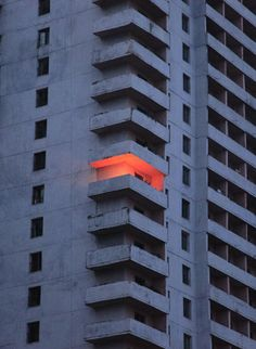 The only ray of light from a Pyongyang apartment block on Tongil Street by fernlicht on flickr