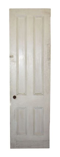 OGT - White painted wood door with unique four panel layout and patina. 83 in. H x 24 in. W x 1.5 in. thick