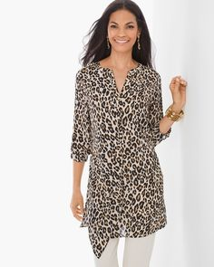 "Cool, calm and commanding. A lightly draped, leopard print tunic falls in flawless formation with a foldover detail, buttoned placket, epaulettes and casual roll-tab sleeves.   Long roll-tab sleeves.   Buttoned epaulettes.   Fold-over drape detail.   Regular length: 33.5"".   Petite length: 31.5"".   Polyester.   Machine wash. Imported."