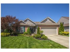 Beautifully landscaped home in the Midview School System has great curb appeal!! Built in 2007, and with only one owner, this home is still young and filled with great amenities! Walk into the foyer, filled with natural light, and to the left you will see the first of 2 full bathrooms. To your right is the spacious front bedroom; fully carpeted. Continue on to the large family room, with built in bookshelves and a relaxing, see through gas fireplace! This unique fireplace connects to the…