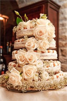 ivory wedding cake with roses and baby's breath