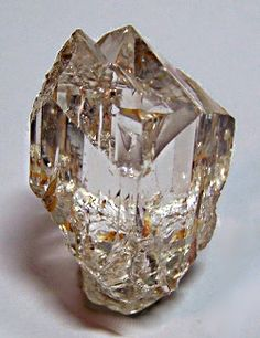 """Topaz - Sakangyi, Mogok, Burma . 1 1/2"""" x 1"""". Extremely clear with very sharp termination. Collected in 1997. Pale champagne color.Wrights Rock Shop Classics Gallery 12.      Via Deanne Guenther"""