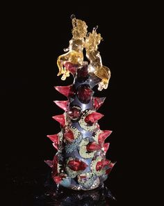 Dale Chihuly,  Silver over Navy Blue Putti with Spotted Raspberry Prunts  (1994, glass, 23 x 10 x 10 inches)