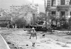THE BOSNIAN CIVIL WAR 1992 - 1995  A Bosnian Muslim refugee walks down a devastated street in East Mostar after Serb forces had been expelled from the town by a joint Bosnian-Croat attack