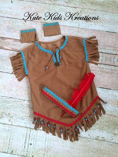 Girls Native American Indian Inspired Costume. This is a great outfit to wear for Halloween, Thanksgiving, plays, pageants, and just to have fun playing Indian. Dress is a tobacco brown suede cloth with hand cut fringe at the sleeves and hem. It is embellished with rick rack and beads on the hem fringe. The outfit includes adjustable headband and ankle bands. . ♥THIS LISTING IS AVAILABLE IN SIZES 2/4, 6/8, and 10/12. THIS LISTING IS MADE TO ORDER WITH A TWO WEEK PLUS MAILING TIME FOR ME TO…