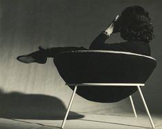 The late Italian-Brazilian architect and designer Lina Bo Bardi reclines in the semi-spherical 'Bowl Chair' she designed in 1951