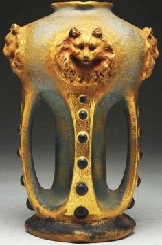 Amphora Ceramic Vase.With four handles and blue beads. Top of the vase has four faces and cat heads in relief. Impressed Amphora oval, Amphora crown