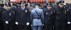 NYPD officers turned their backs on New York Mayor Bill de Blasio at Wenjian Liu's funeral Sunday, a week after shunning him at the funeral for Rafael Ramos on Dec. 27, despite Police Commissioner Bil