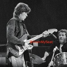 The Band's Robbie Robertson and Levon Helm perform at the Forum during Tour '74.