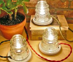 Being an ex-telephone installer I have a large collection of insulators in various colors. I think that I could do this!!! - Glass Hemingray Lamp