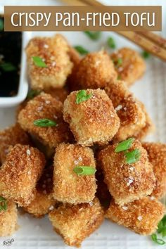 If you think you don't like tofu, you've never tried it like this! Crispy Pan-Fried Tofu has a crunchy golden exterior that's the perfect complement to the soft tofu. This easy recipe, paired with a bold and spicy dipping sauce, is a mouthwatering appetizer or snack #tofu #panfriedtofu #friedtofu #vegetarian #easyrecipe Easy Desserts, Easy Dinner Recipes, My Recipes, Holiday Recipes, Easy Meals, Dessert Recipes, Holiday Foods, Pan Fried Tofu, Crispy Tofu