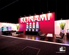Need to grab some attention?  Nothing like sticking your large scale logo on a vibrant pinkish red wall like Konami did for NSW Clubs show in 2012!