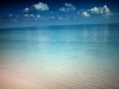 Clear water reflecting the clouds - Treasure Cay - Abaco, Bahamas