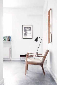 Pared back minimalist style with polished concrete floor and Scandianvian style furniture